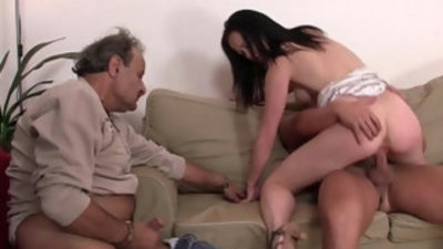 Old husband watching wife riding