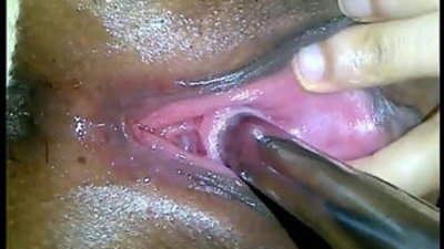 Peehole fucking her pussy with big dildo